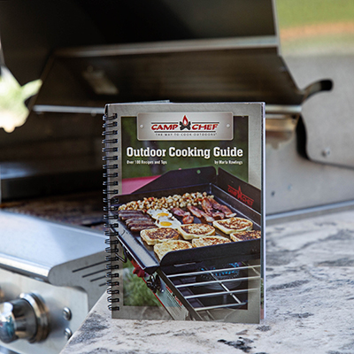 CAMP CHEF<sup>®</sup> Outdoor Cookbook - This outdoor cooking guide is filled with over 100 recipes and tips to have you cooking like a pro.  Whether you love patio cooking, tailgating, barbecuing or camping, there are dozens of easy-to-follow recipes in this cookbook.