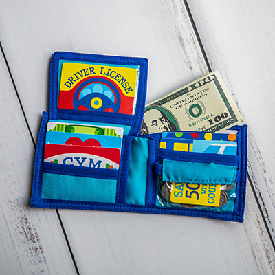 MELISSA & DOUG<sup>&reg;</sup> Pretend-to-Spend Wallet - For both playtime and learning, this 45-piece fun wallet includes make-believe dollars and coins, store and membership cards and driver's license.  Not recommended for children under 3 years old.